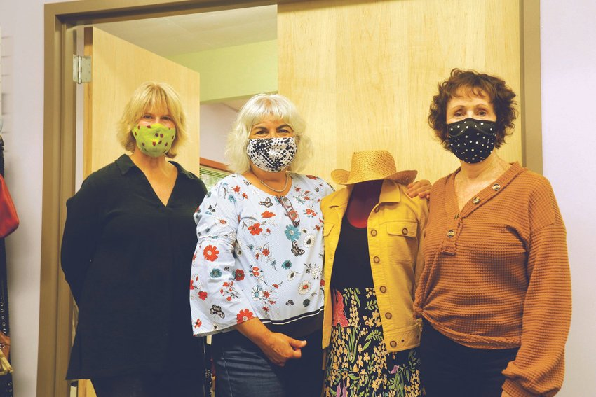New Image Board Members, Leslie Freeman, Martha Olbrych and Jeanne Clark, from left, pose with a mannequin displaying a typical outfit curated for the nonprofit's clients.
