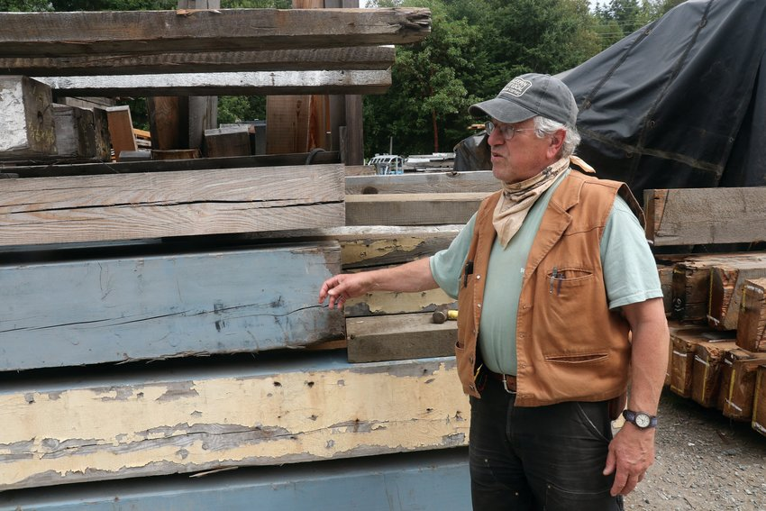 Jake Jacob of Pacific Northwest Timbers explains the provenance of the reclaimed wood that fills his lumber yard.