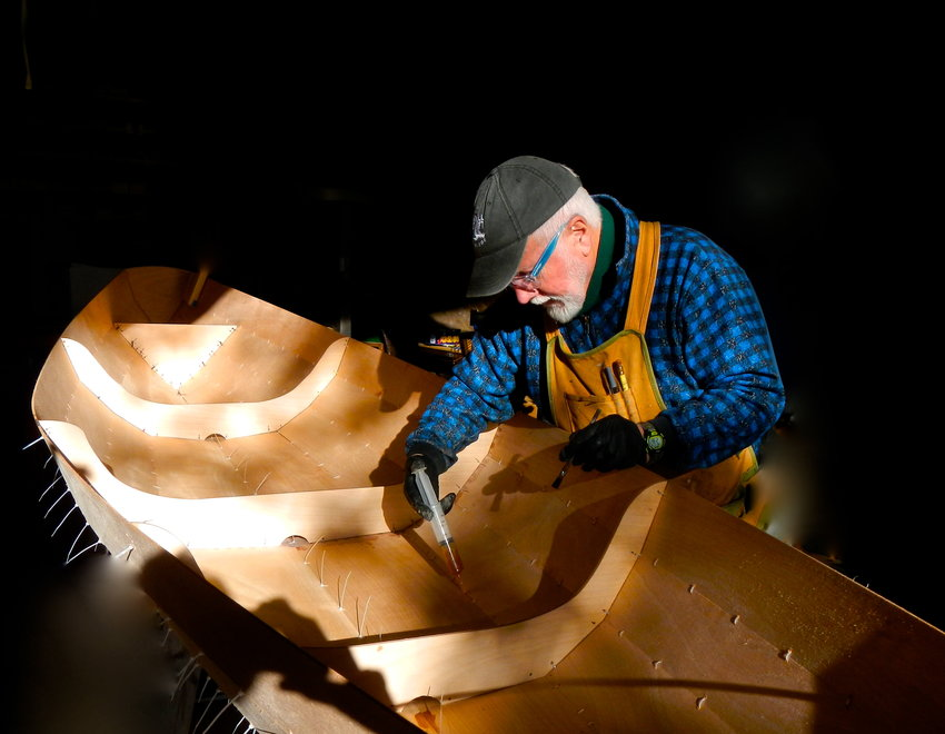 Marty Loken constructs a wooden boat using stitch and glue construction. Photo courtesy Marty Loken