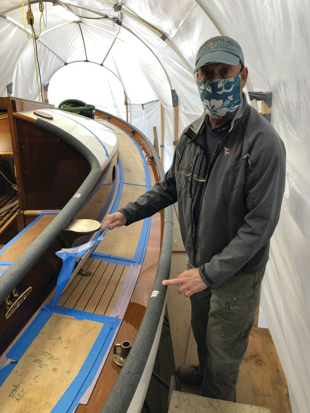 Robert d'Arcy, captain of the schooner Martha, overseeing a project for Robert d'Arcy Marine Services.