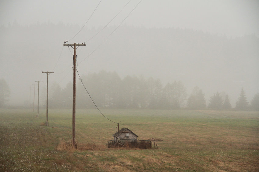 Smoke blankets farmland in Chimacum.