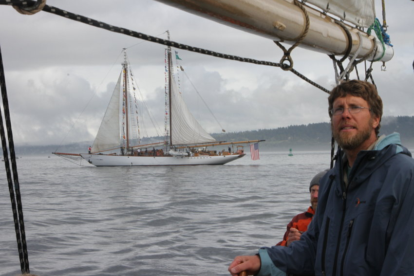 Aaron Wenholz, of Poulsbo, captains the 72-foot schooner Red Jacket as the much-larger 133-foot Adventuress comes about astern.