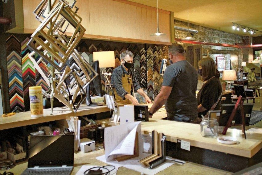 David Wing-Kovarik of Frameworks Northwest works in his Taylor Street shop.
