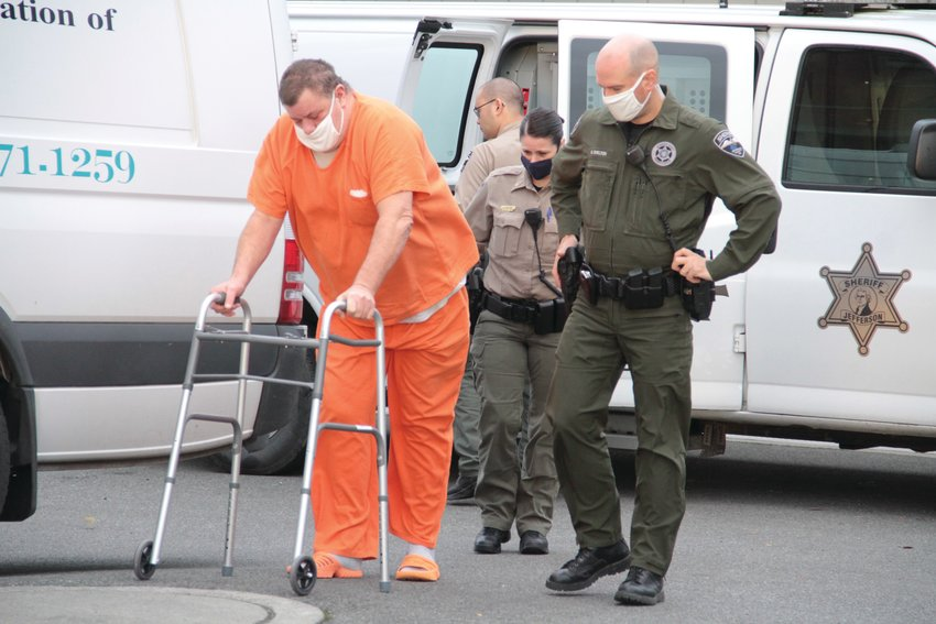 John Paul Beckmeyer makes his way to the entryway of the Jefferson County Courthouse Friday for a pretrial hearing prior to his upcoming trial for first-degree murder. Beckmeyer, 59, is accused in the death of James McDonald following a fatal shooting Aug. 26 in Nordland.