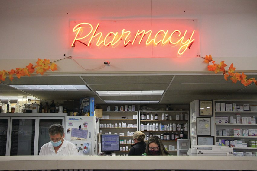 Pharmacist Don Hoglund works behind the counter at his pharmacy, Don's Pharmacy. Hoglund recently announced that he plans to sell the business, but will remain on staff.