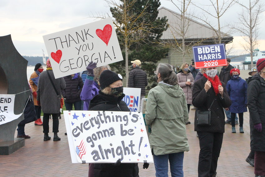 Demonstrators show their support for President Joe Biden and Vice President Kamala Harris' inauguration on Wednesday at Pope Marine Park in Port Townsend