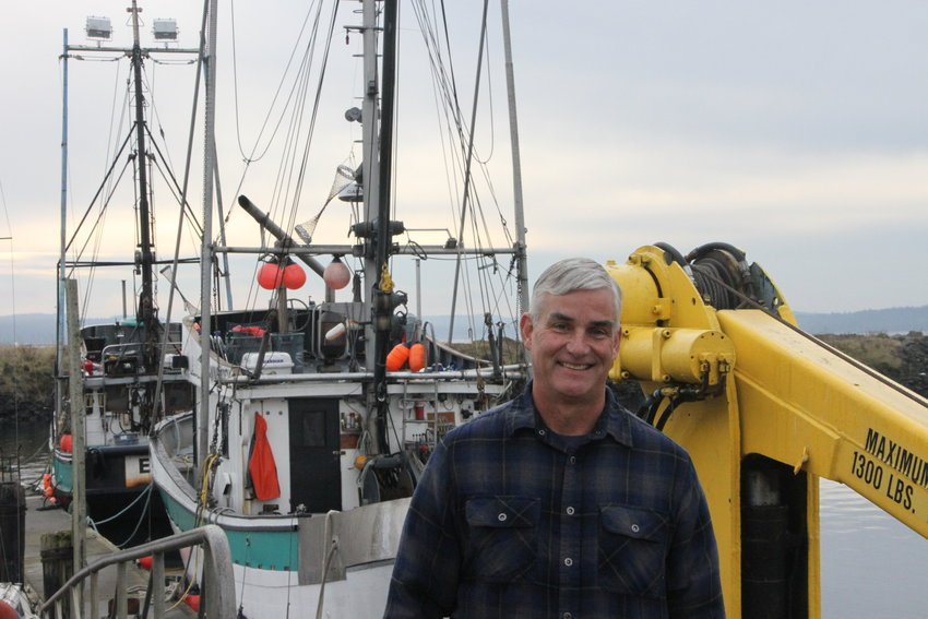 Scott Kimmel, owner of New Day Fisheries stands in front of his fishing boats, Adriatic and Ellie-J.