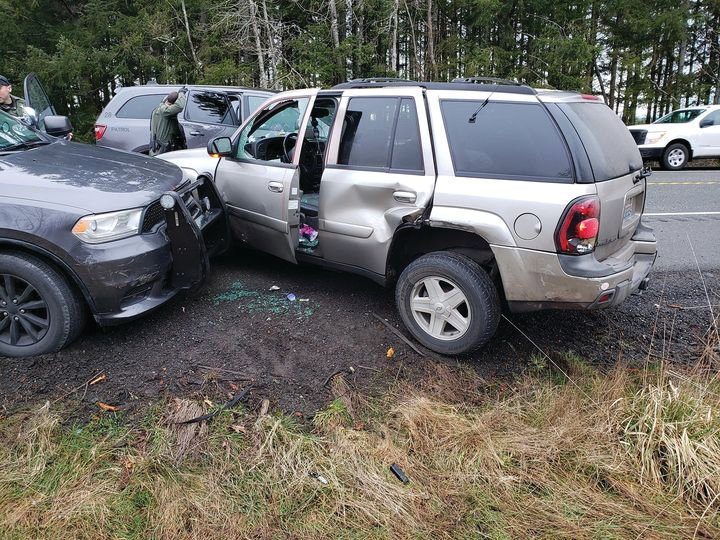 An SUV that was involved in a police chase involving a Port Angeles man sits on the shoulder of Highway 104 after it was stopped by deputies with the Jefferson County Sheriff's Office Thursday morning.