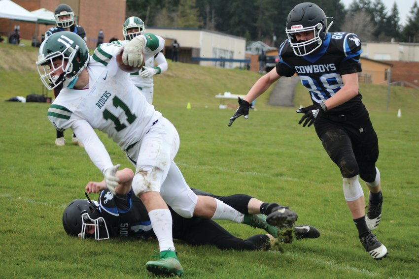East Jefferson linebacker Joe Savill is in hot pursuit of a Roughriders runner during the varsity football matchup against Port Angeles last week.