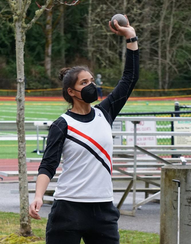 Senior Gina Brown prepares to put the shot during East Jefferson's season opener in Kingston.