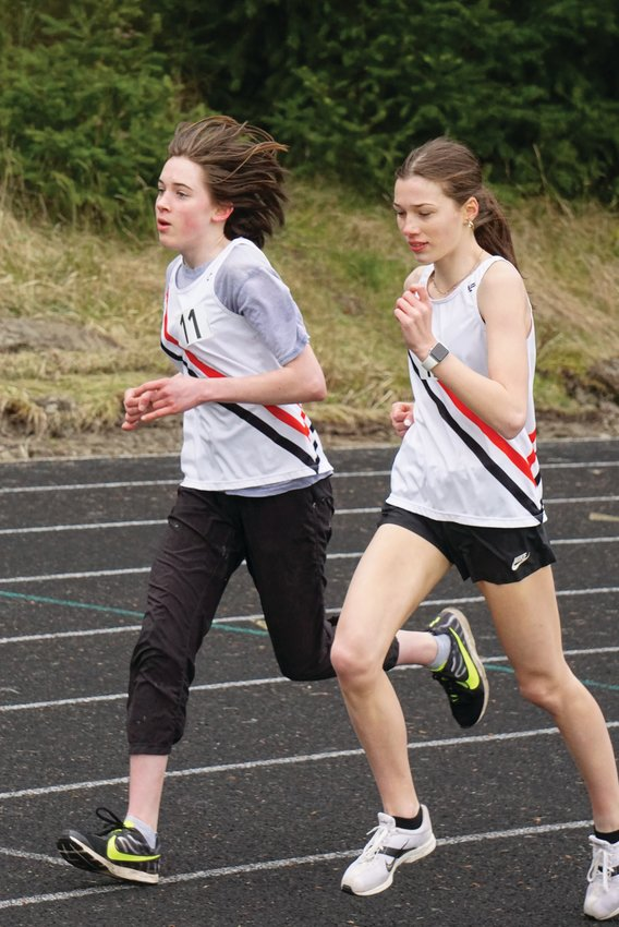 Fiona Fraser left and Aliyah Yearian  round the track during last week's track meet in Port Townsend.