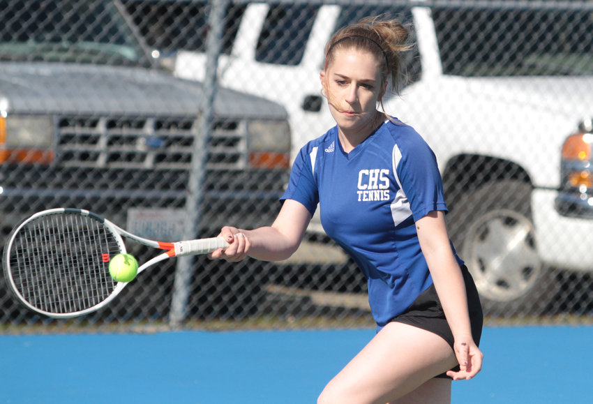 East Jefferson's Madison Hess returns the ball in girls No. 1 singles against Sierra Denning of the Buccaneers.