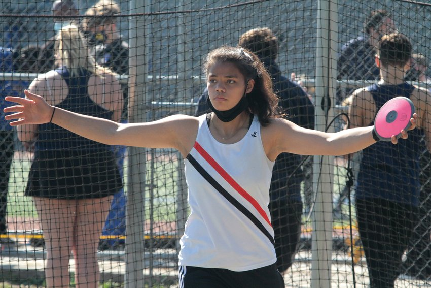 Gina Brown prepares to throw the discus during East Jefferson's visit to Bainbridge Island Saturday for a track and field meet.