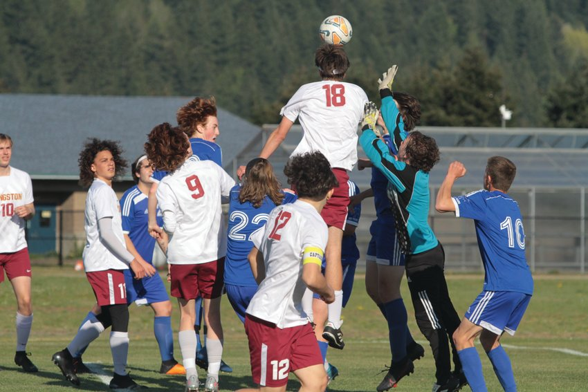 EJ keeper Haven McMillan reaches up to block a header during East Jefferson's meeting with the Buccaneers last week.