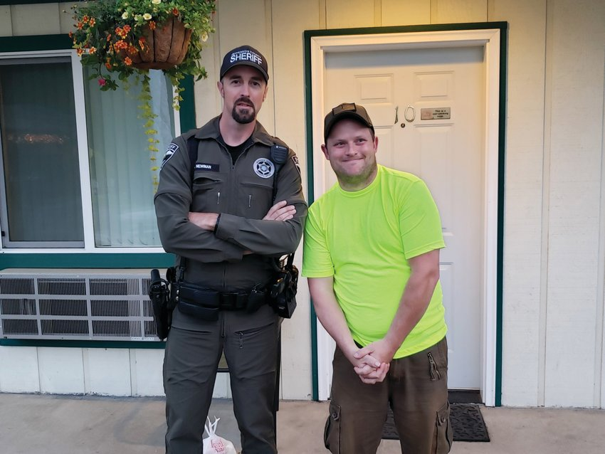 Adam Newman and Zach Hook pose for a photo during a meet-and-greet arranged by Jefferson County sheriff's deputies.