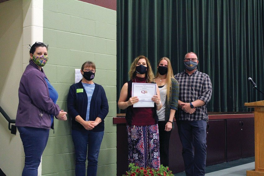 Jessica Gossette, Cindy Pollard, Kimberly Knudson, Trisha Freiberg, Frank Redmon pose for a photo after Knudson was awarded the Excellence in Education Award during a recent ceremony.