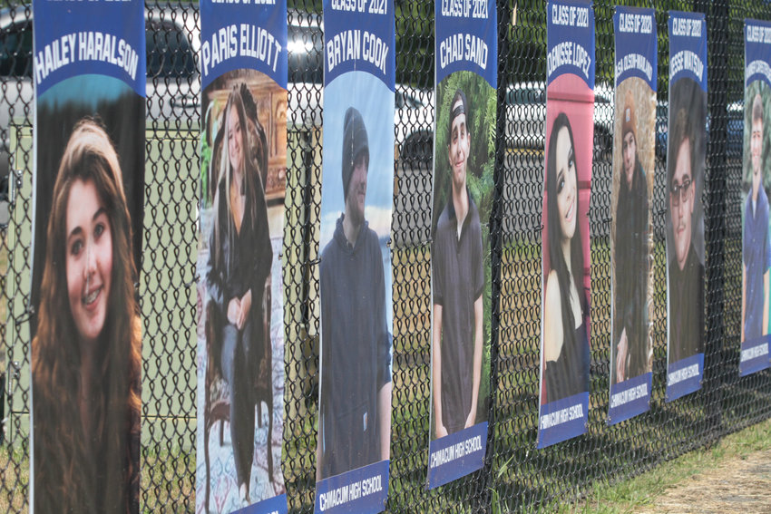 Banners featuring Chimacum's Class of 2021 hang on the fence outside the school.