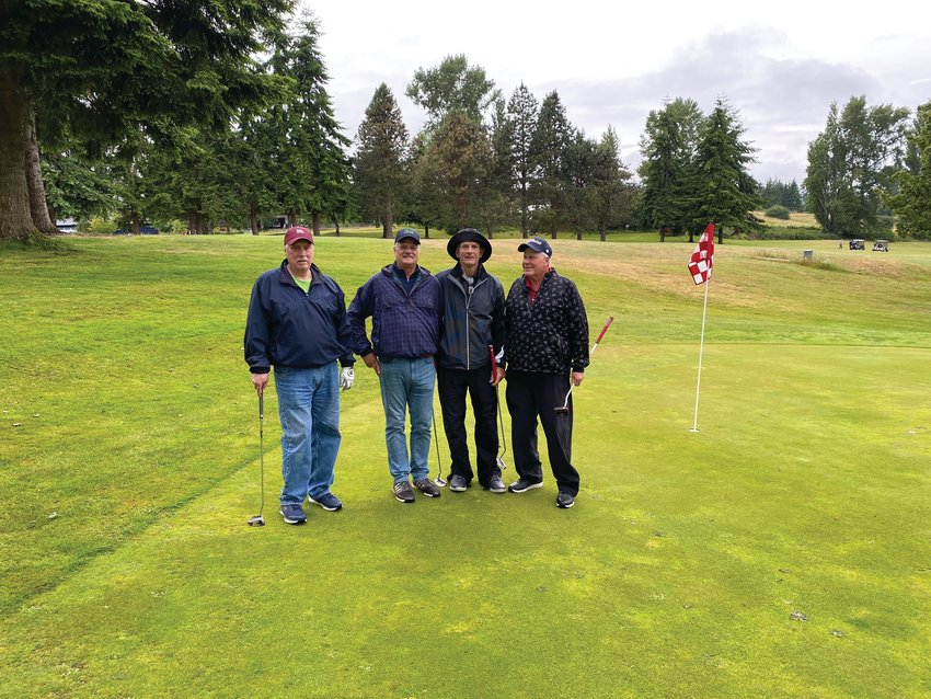 Phil Caldwell, Tim Caldwell, Jim Fultz, and Woody Woodley participated in the rainy Sunday Scramble at the Port Townsend Golf Course.