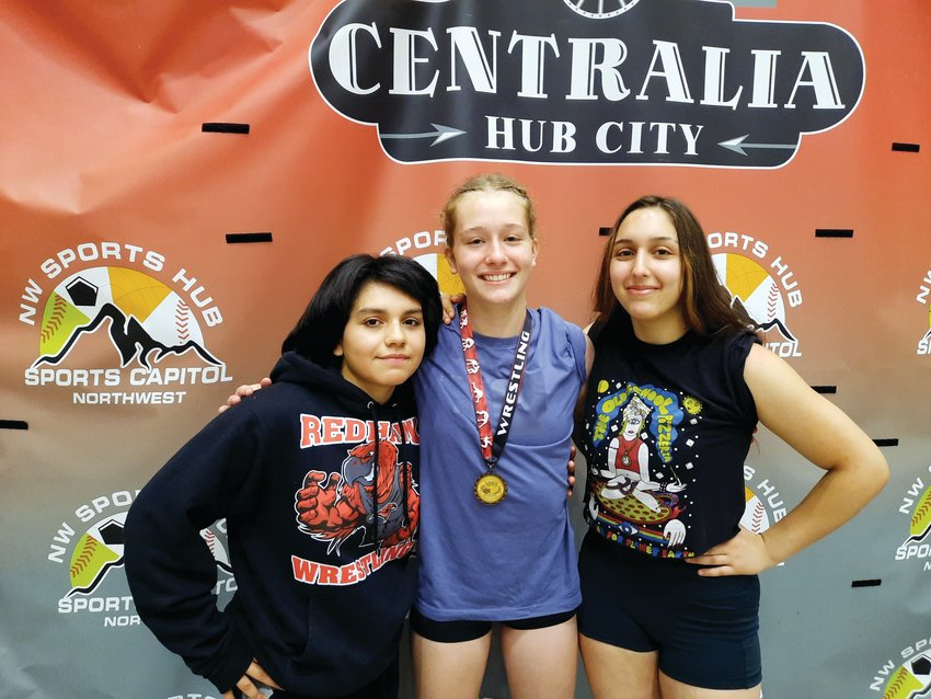 Lily Delgado, Savannah Hoffman, and Chloe Lampert gather for a photo at the Super State Wrestling championship in Centralia.