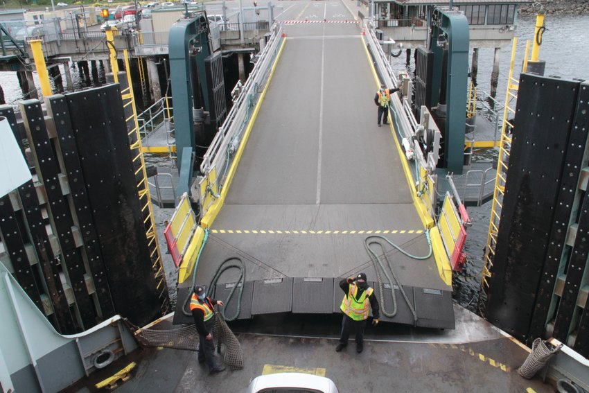 WSF workers lower the ramp at the Port Townsend Ferry Terminal after the arrival of the ferry M/V Kennewick.