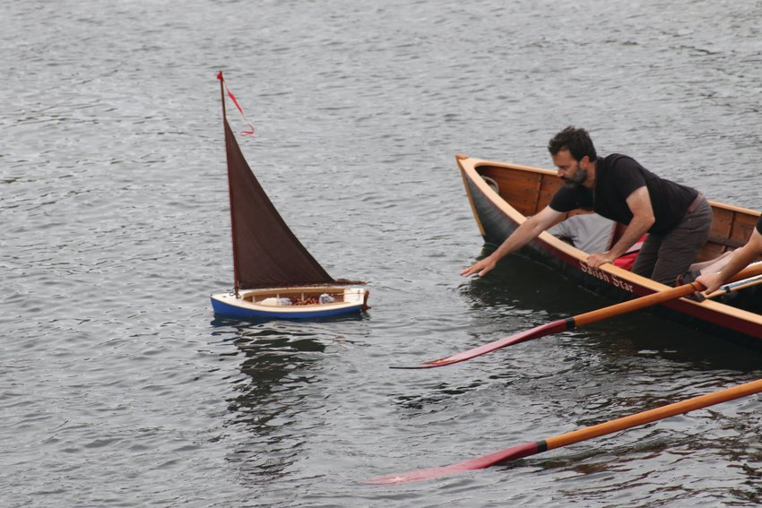 Ian Weedman, Brion Toss' apprentice, launches a model sailboat carrying his mentor's ashes.