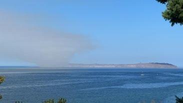 Smoke rises over Protection Island mid-morning on Tuesday.