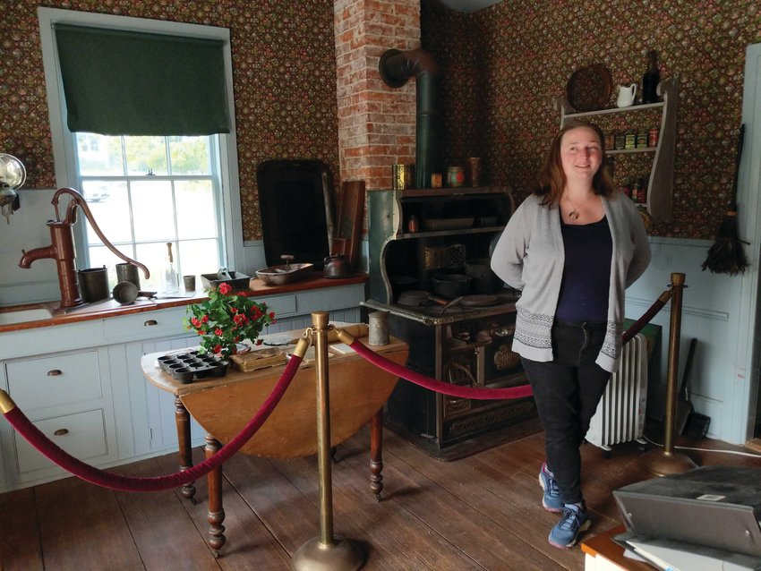 Erika Chester stands in the kitchen of the historic Rothschild House.