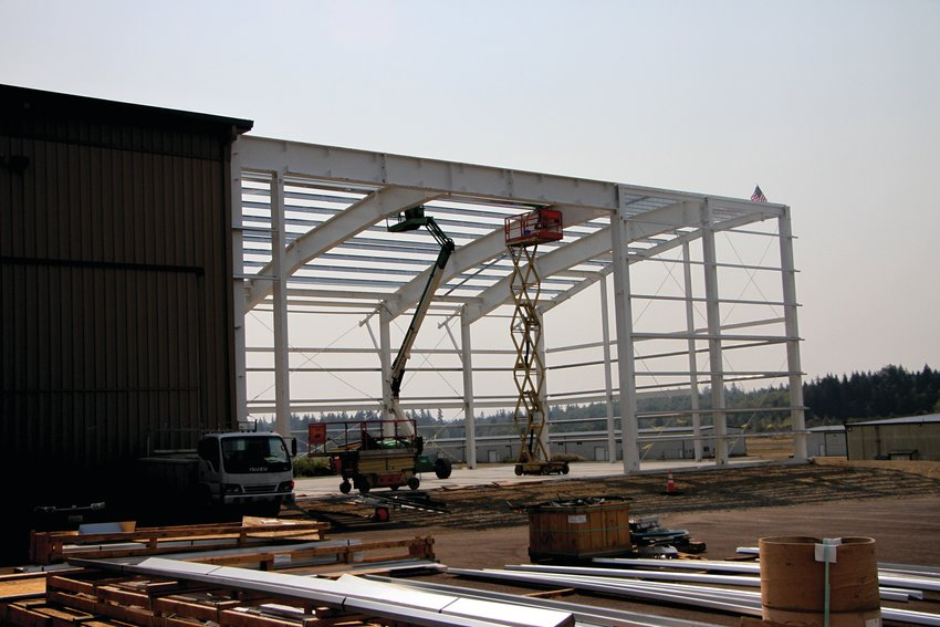 Steel beams frame the museum expansion, as workers prepare to eventually add large windows and high efficiency propane boilers to the new section.