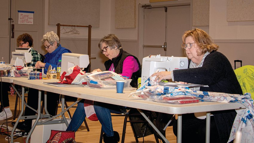 Members of Quilts of Valor gather to make quilts for military veterans.