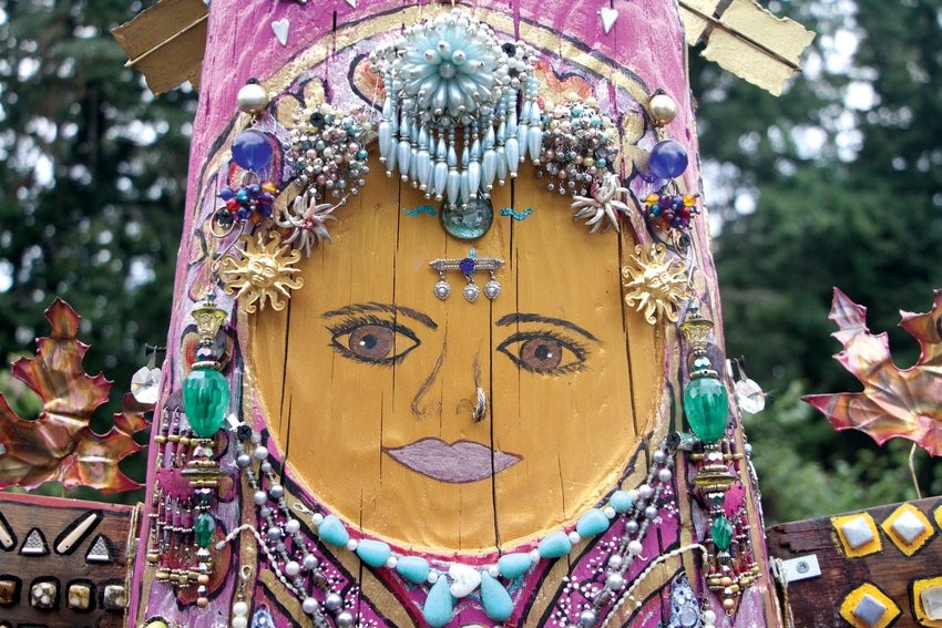 Judy Gelwicks carved and painted the lady's face early on in the project. Neighbors, friends, and family members added pieces of jewelry to the sculpture over time.