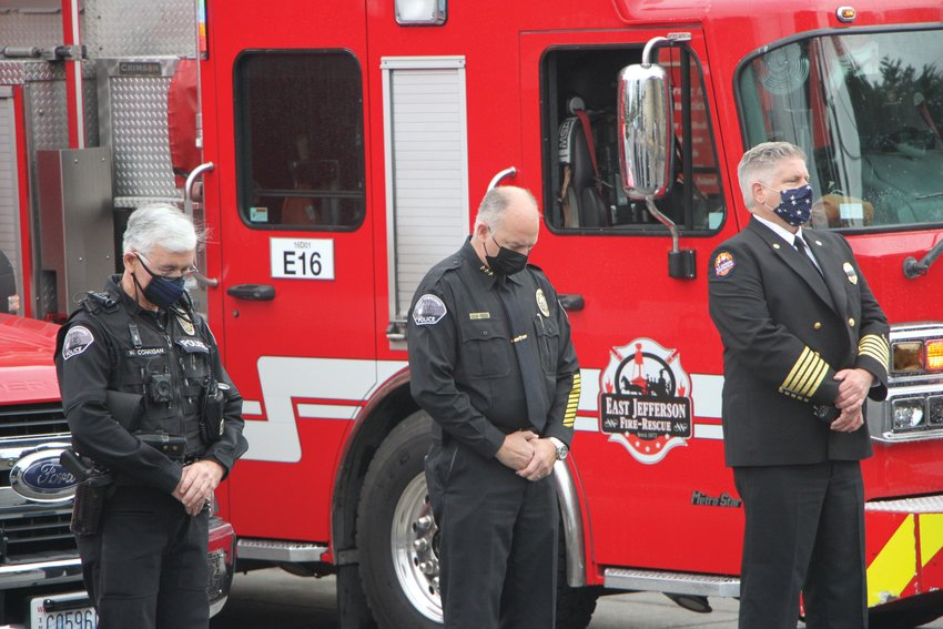 """Port Townsend Police Chief Thomas Olson (center) and East Jefferson Fire Rescue Fire Chief Bret Black (right) stand for the moment of silence, honoring service members who lost their lives helping others on Sept. 11. """"This is what we're prepared to do, we run in when everyone is running out,"""" Police Chief Olson said."""