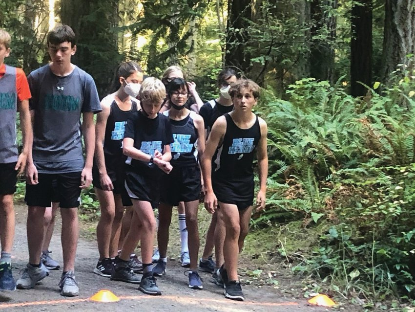 Ready to race, in the front line, are Noah Isenberg, Leah Ferland, and Grady White, while Sienna Emerson, Lily Justis, and Michael Gregg are ready to kick off in the second line. Port Townsend runners not pictured but who participated in the race are Bella Ferland and Atom Barrett.