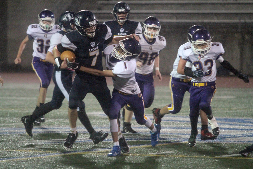 Jayden Love tries to force a fumble during second-half action.