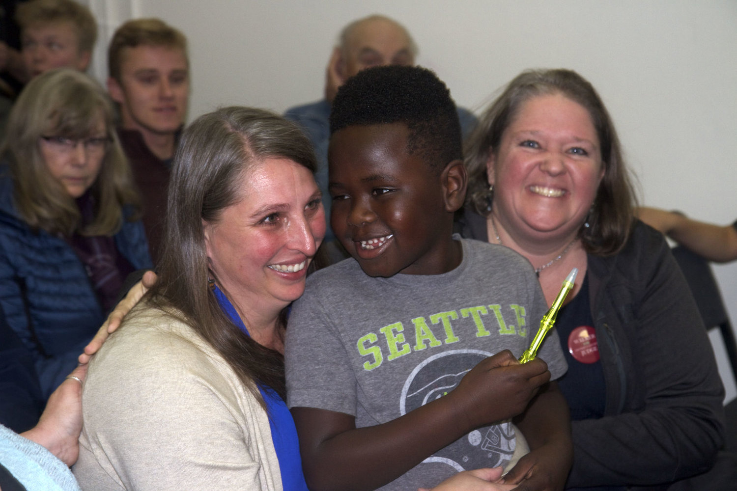 Mindy Walker, seen here holding her son Kasongo Thompson, is all smiles after hearing she led the race for District Court Judge during the announcement of initial results at 8 p.m., Nov. 6, at the Jefferson County Courthouse. Her supporter, Amanda Wilson is seen at right. Walker, with 9,135 votes cast, or 58.16 percent, likely will become District Judge. Her opponent, Noah Harrison, trailed behind with 6,572 votes cast, or 41.84 percent.
