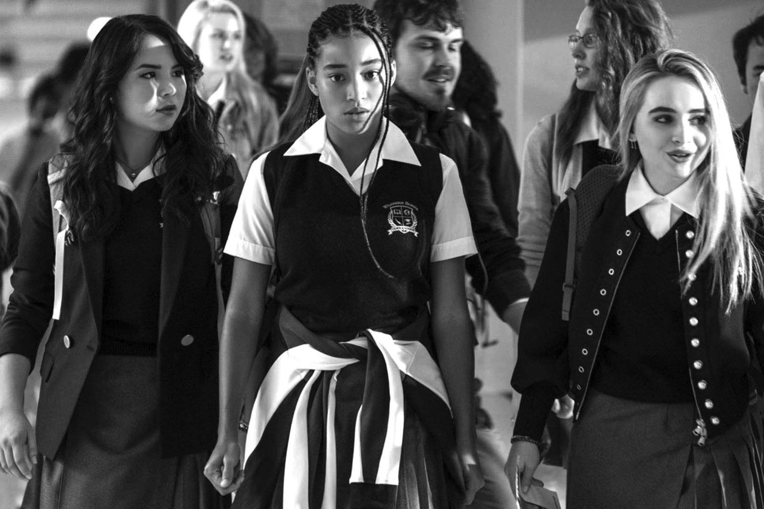"Starr Carter (Amandla Stenberg, center) struggles to fit in with her white classmates in ""The Hate U Give."""