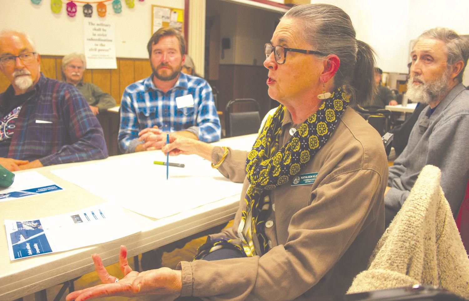 Jefferson County Commissioner Kathleen Kler expresses her concerns to representatives of the state Department of Commerce about the military's land use development rights over the county, during an Oct. 30 meeting to solicit public input at the Tri-Area Community Center.