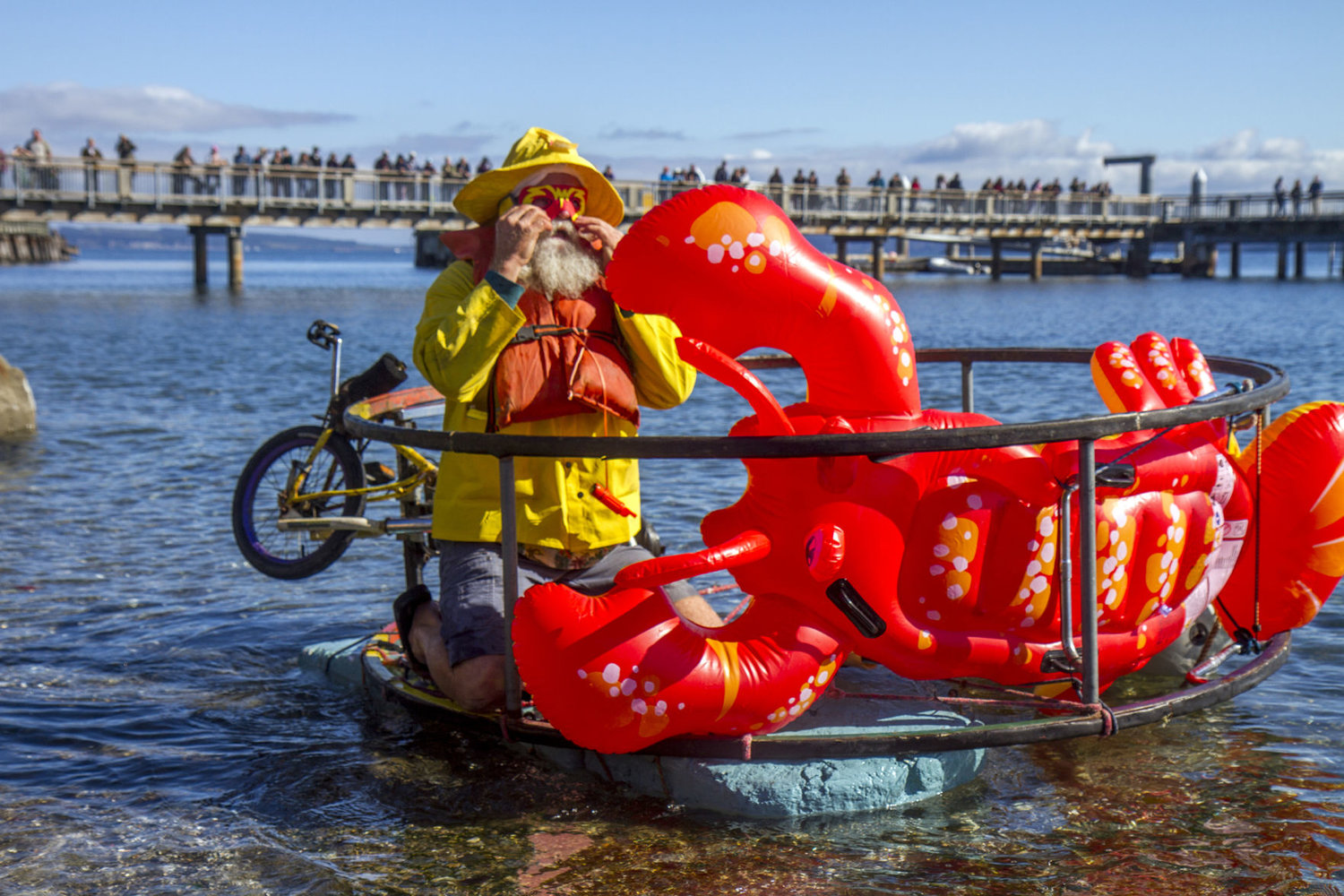 "Peter Wagner, of Davis California, wrestled with his ""lobster trap"" sculpture during the water race Oct. 6."