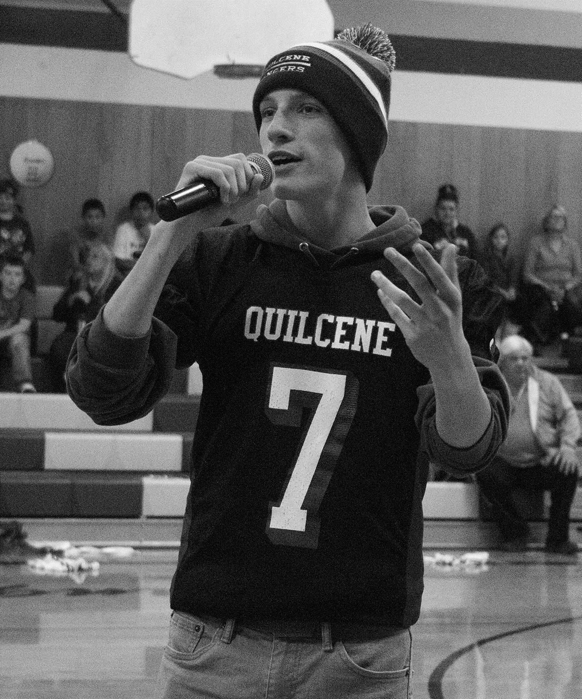 Junior quarterback Holdem Elkins addresses his fellow students to remind them of the football team's undefeated season.