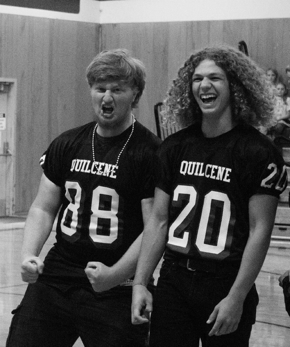 Junior offensive lineman Max Redmon and freshman running back Ashton Smead get their classmates psyched for the football team's game against Evergreen Lutheran on Saturday.