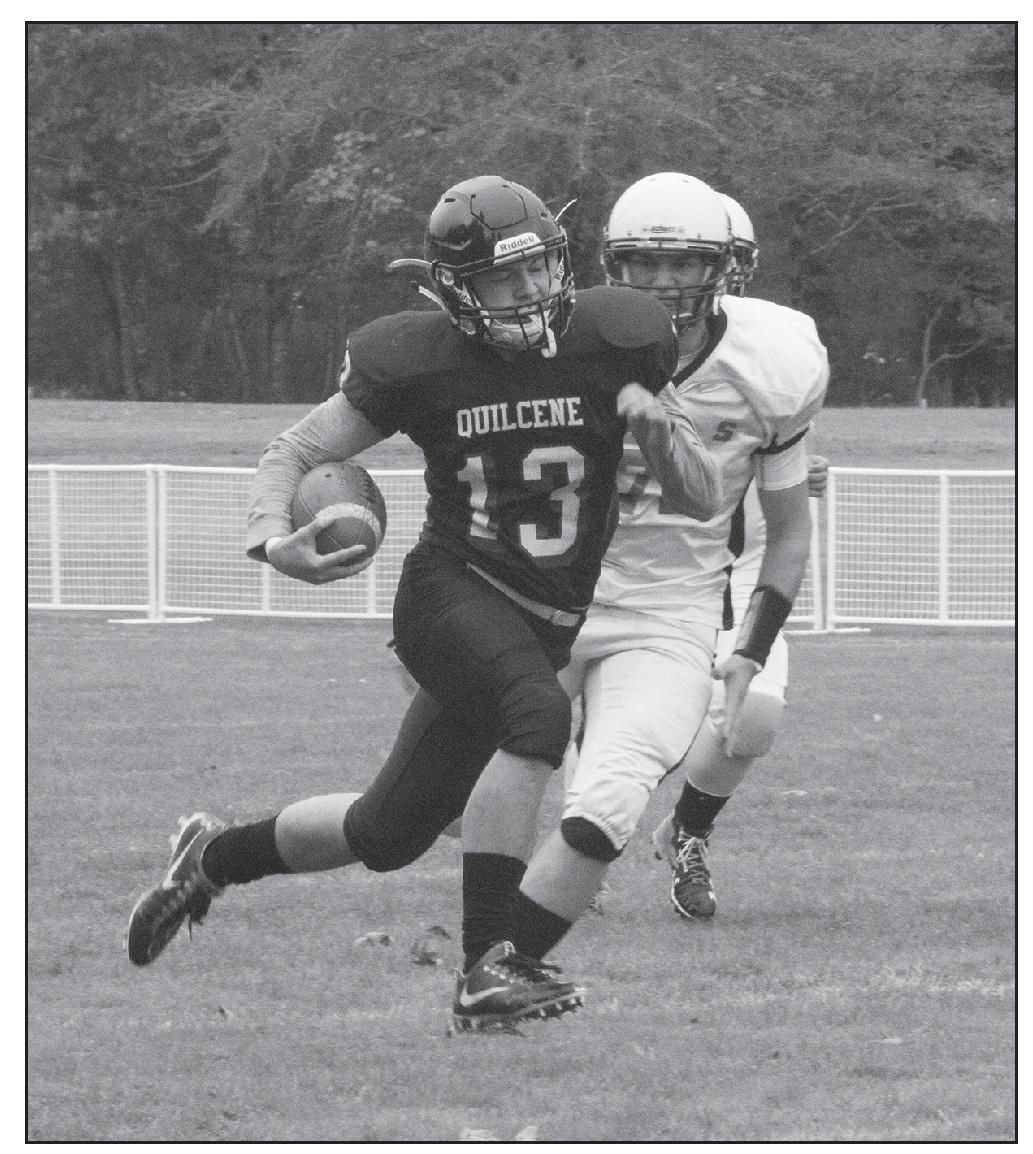 Quilcene's Olin Reynolds runs the football down the field during a play on Saturday against Evergreen Lutheran.