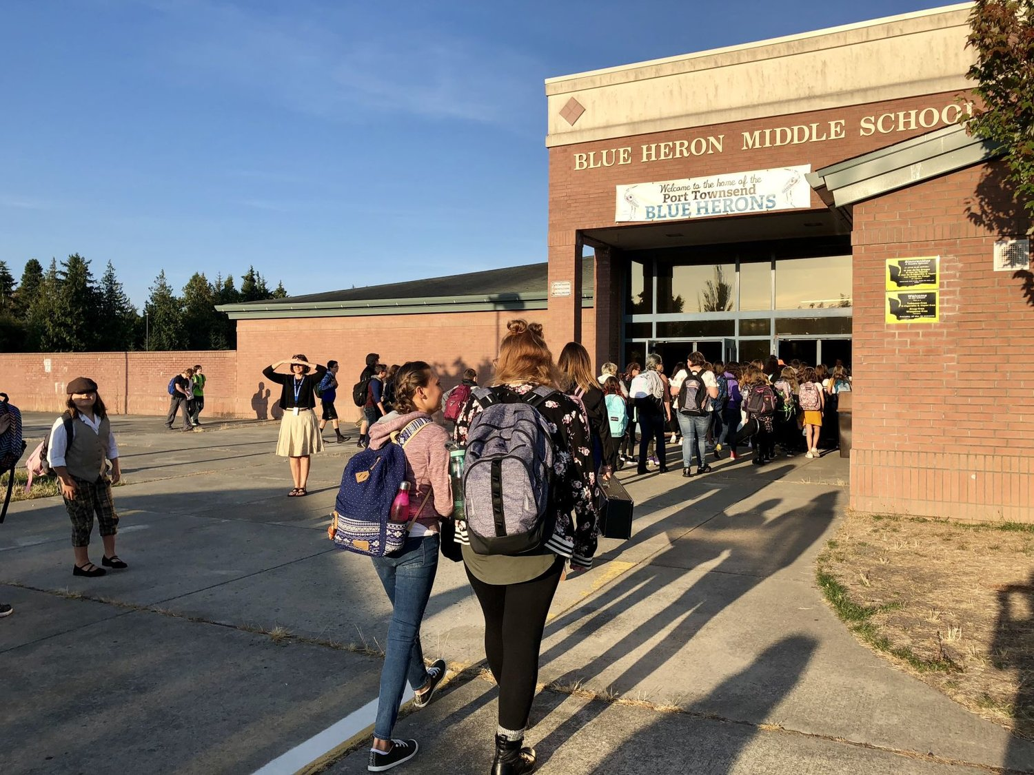 Students pour into Blue Heron Middle School, which was reduced from grades 4-8 last school year to grades 6-8 this school year, at the start of the 2018-19 school year on Sept. 4.