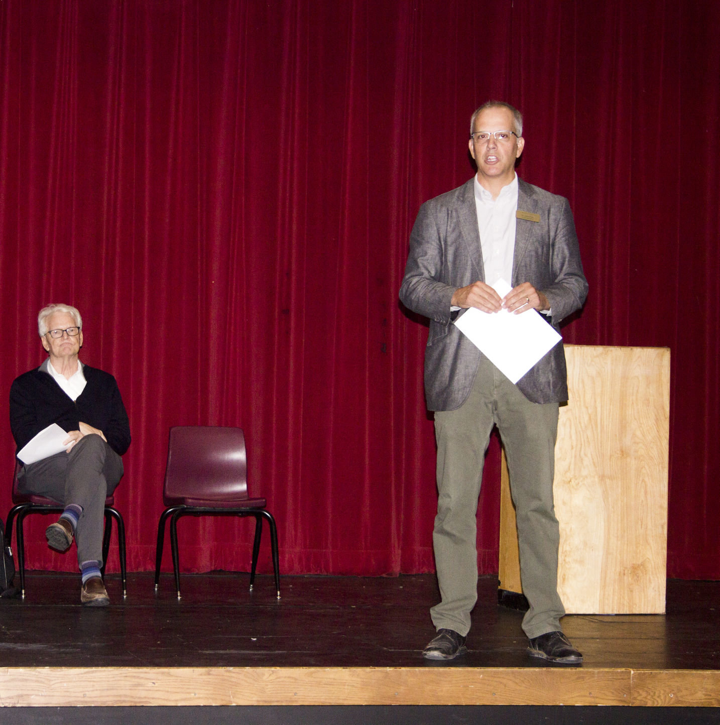 From left, Salish Coast Elementary Project Manager Kirk Robinson, left, looks on as Port Townsend School District Superintendent John Polm answers questions from parents and community members at the Port Townsend High School Auditorium on Aug. 30.
