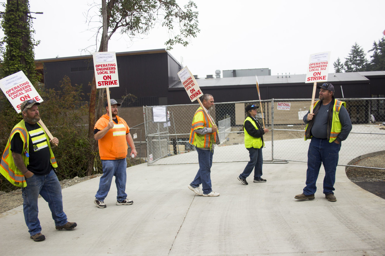 Members of the International Union of Operating Engineers, Local 302, took up pickets and marched at the site of Salish Coast Elementary Aug. 23. Leader photo by Kirk Boxleitner