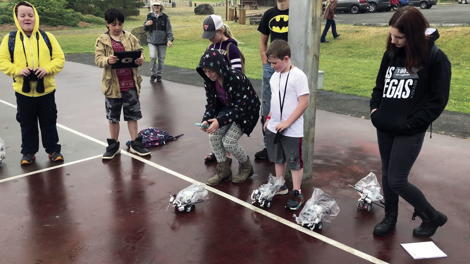Al Gonzalez's students test-drive their robots to verify their building and programming skills. Courtesy photo