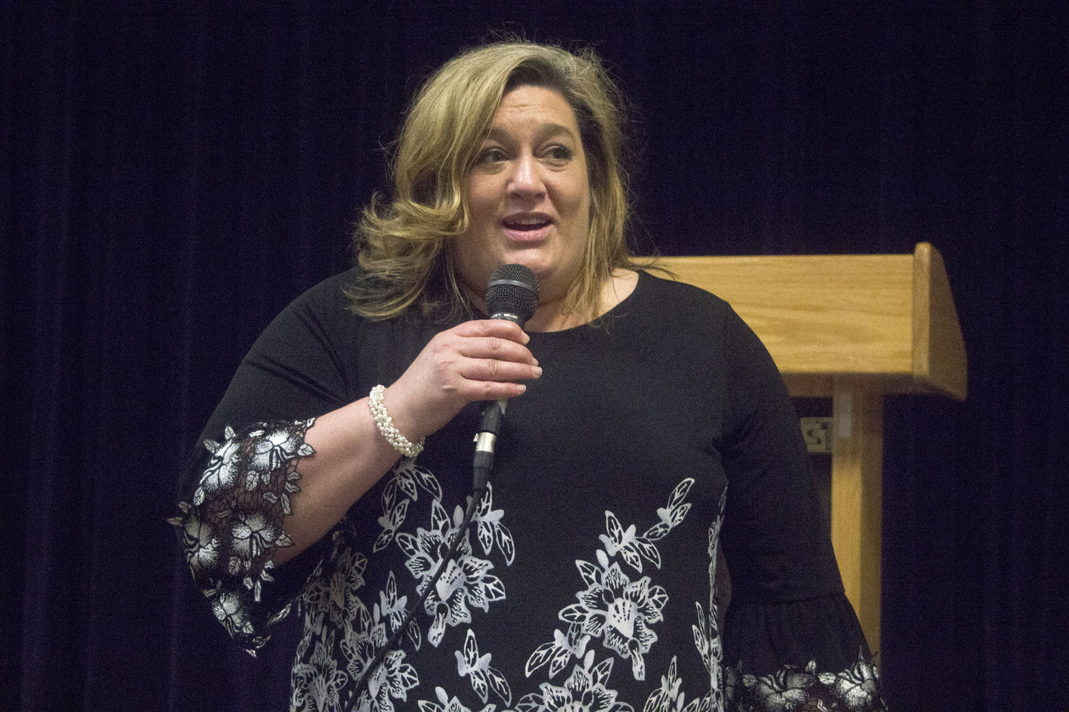 Kristi Queen, a former assistant principal Shorecrest High School and the Mukilteo Explorer Middle School in Everett, speaks to parents and community members at Blue Heron Middle School June 22.
