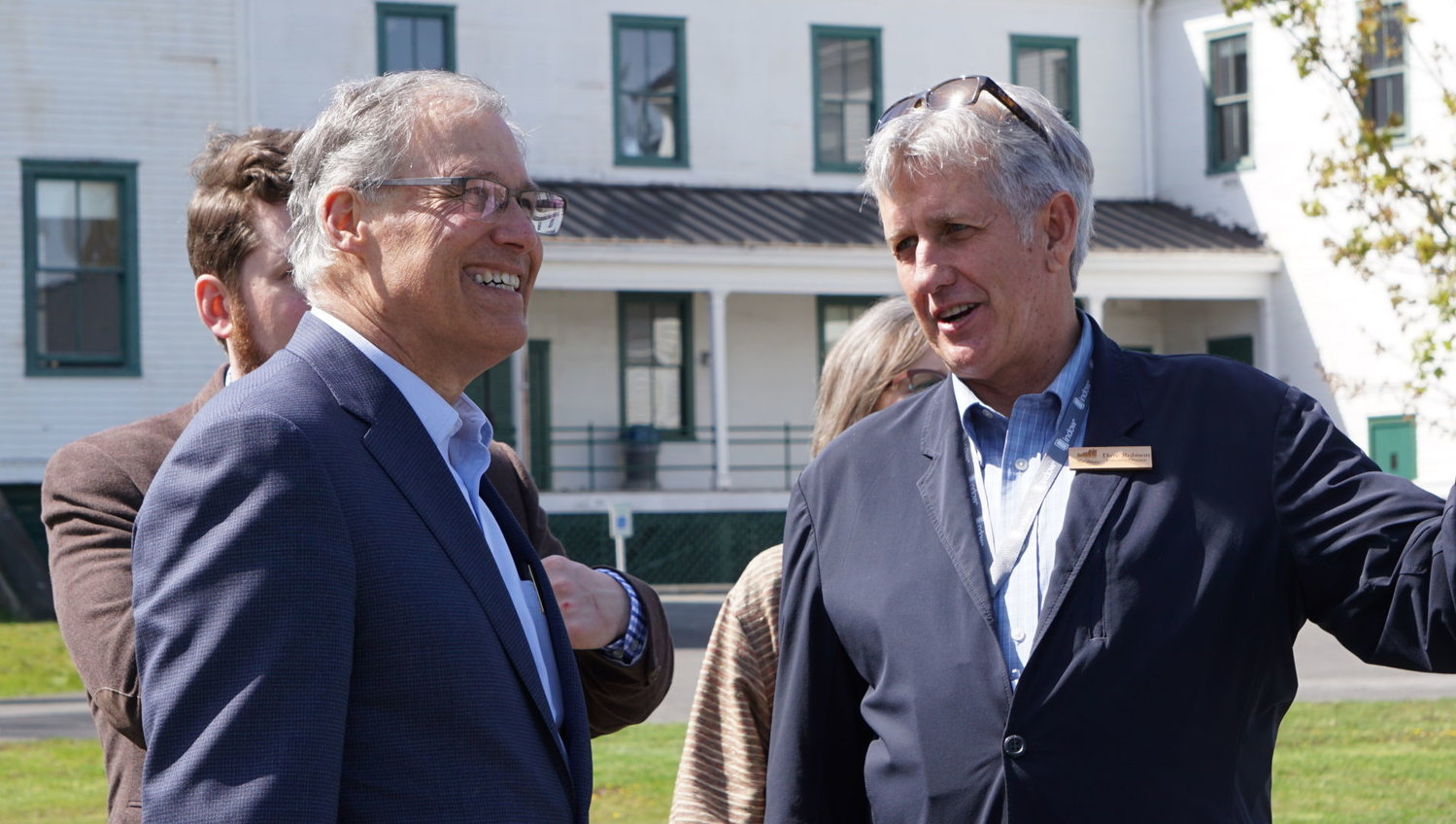 Gov. Jay Inslee speaks with Fort Worden PDA Executive Director Dave Robison during Inslee's first visit to the historic site since being elected.