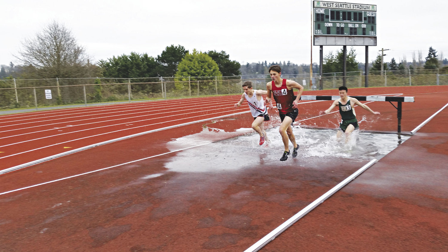 Port Townsend High School track and field member Seamus Fraser pulls away from the eventual fourth- and fifth-placers in the steeplechase, before coming in third at the West Seattle Stadium March 17. Photo courtesy of Ian Fraser