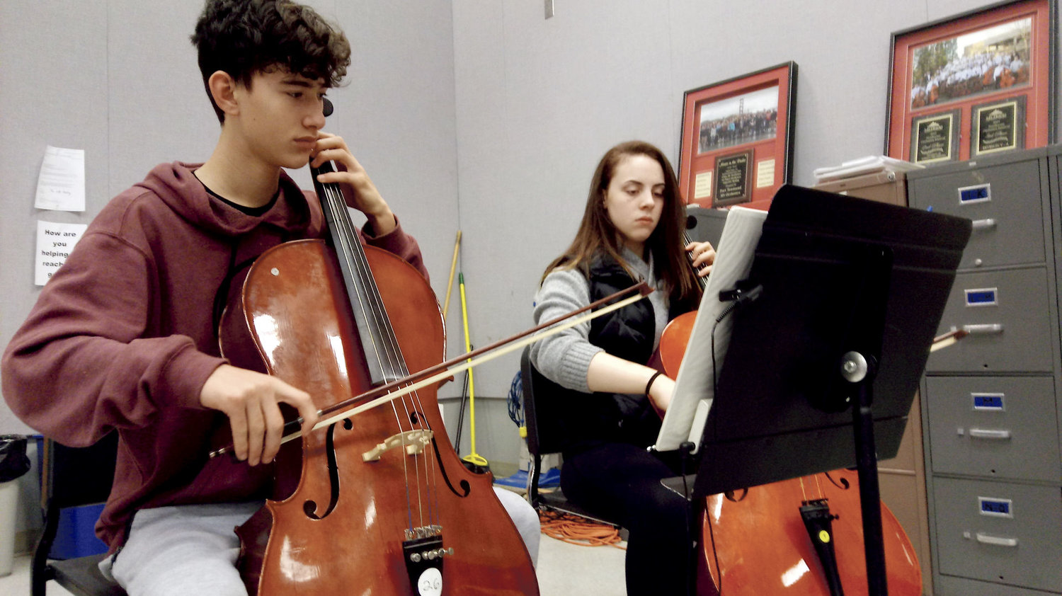 "Trillium DeWyse, left, and Jamie Rogers concentrate on hitting the right notes of ""Frolicsome Finale."" The Port Townsend High School Orchestra is currently raising funds to go to Los Angeles. A fundraising dinner is set for Feb. 10. Photo courtesy Kailee Kunz"