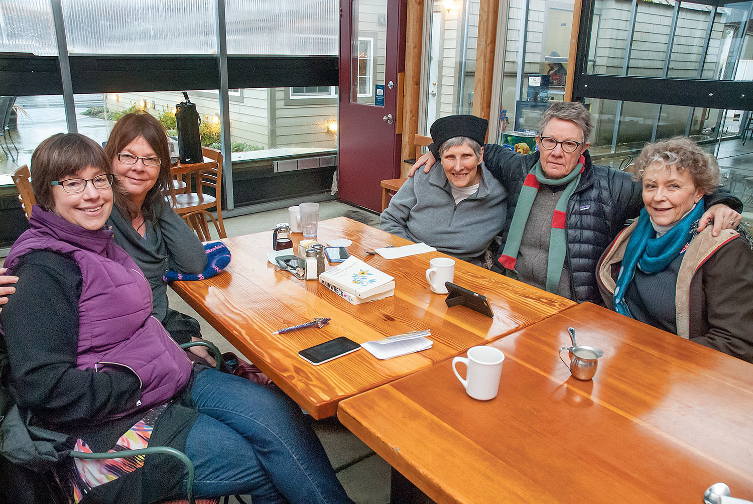 The Nest Egg Project members (from left) Celeste Bennett, Juliet Parfrey, Trish Walat, Lauri Chambers and Linda Brewster meet at The Cup restaurant in Port Townsend. Photo by Chris Tucker