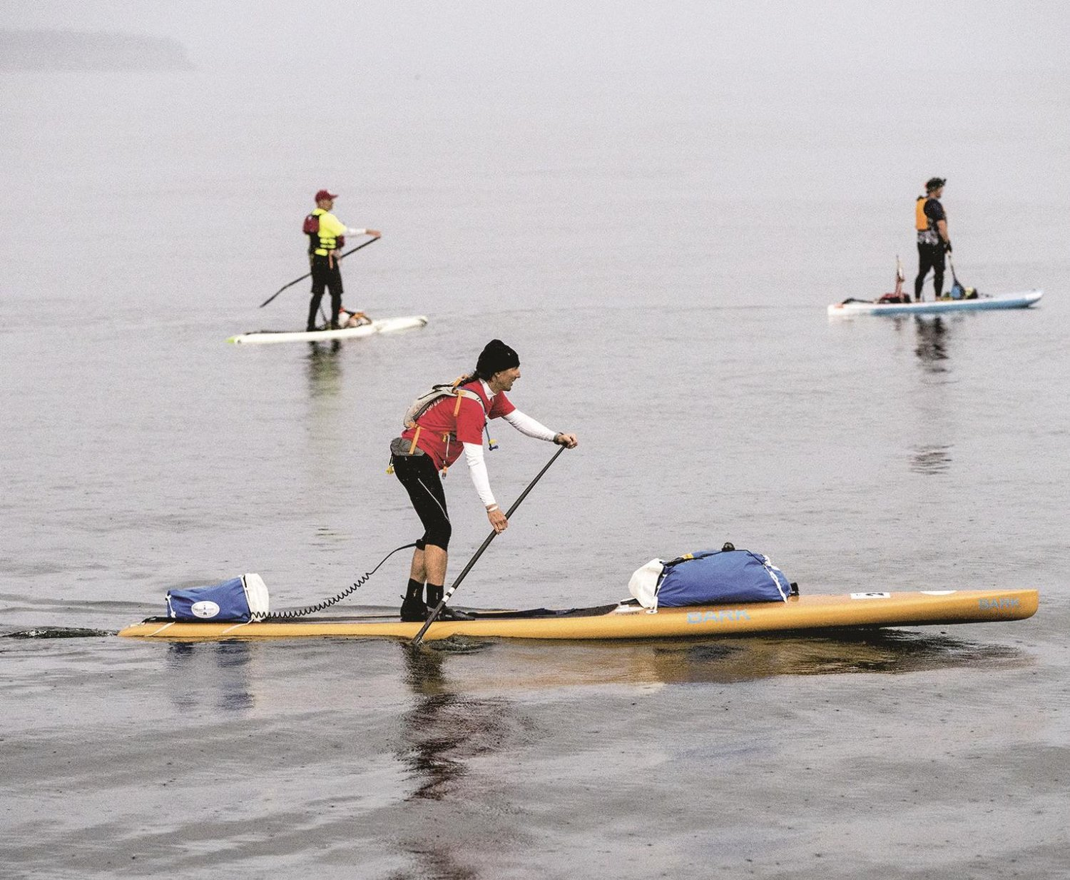Stand-up paddleboarders, including Karl Kruger of Orcas Island (foreground), started out in June to cross the Strait of Juan de Fuca and paddle on to Victoria for the first leg of the third Race to Alaska, the 750-mile race from Port Townsend to Ketchikan, Alaska. Kruger went on to become the first person to finish the R2AK race on a stand-up paddleboard.